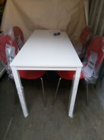 Dining room table in white and 4 dunelm red chairs