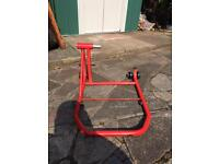 Motorbike side paddock stand for single swing arm