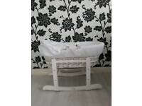 Moses basket in white baby crib with stand