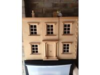 Unfinished dolls house project. Wooden furniture and moveable people.