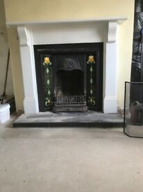 Cast iron fire place with wooden surround good condition