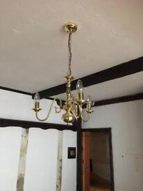 Three brass light fixtures