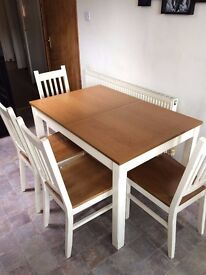 Extendable dining table and 4 chairs. Ideal for use in Kitchen.