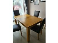Oak dining table with 4 chairs & matching oak sideboard