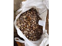 Assorted large decorative garden pebbles, sold in bags of approx. 30kg.