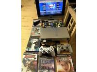 Ps2 bundle/8 games/2controllers