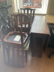 Solid wood drop leaf table and 4 chairs