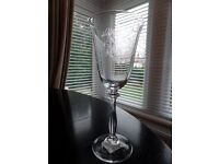 Six unused and boxed Laura Ashley engraved wine glasses