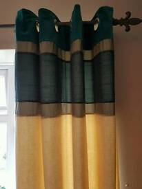 Lovely teal curtains lined.