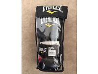 Men's Everlast 14 oz boxing gloves.