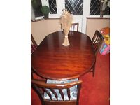 Extendable Mahogany oval table and 4 chairs