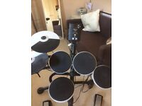 Roland TD1K electronic drum kit. Spare cymbal and drum stool if required
