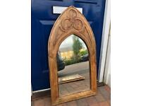 Mirror, solid wood and church window like appearance.