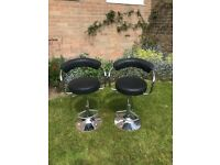 Pair of height adjustable black and chrome kitchen chairs