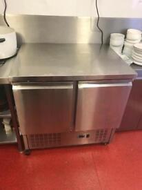 Stainless steel counter fridge.
