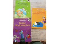 Collection of five French language children's books, CDs and DVDs