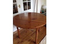Round pine dining table, no chairs