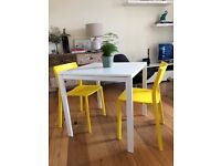 White dining table. Seats 4. Modern and clean design with 'floating top'. Basically new!!!