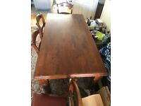 Singaporean solid Mahogany table with 6 leather chairs