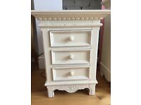 Cream bedside table and chest of drawers