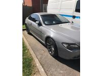 AM SELLING MY 2007 BMW 63OI SPORT COUPE IT'S SILVER BUT ITS WRAPPED IN NARDO GRAY