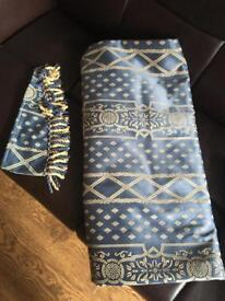 Pair of blue curtains with tie backs