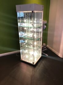 Tall glass display cabinet with lights