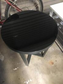Black round table with glass top