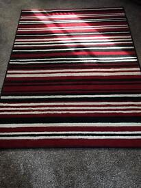 Red black and white striped rug