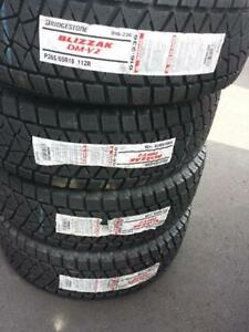 BRAND NEW WITH LABELS ULTRA HIGH PERFORMANCE  BRIDGESTONE BLIZZAK DMV2  265 / 65 / 18 WINTER TIRE SET OF FOUR