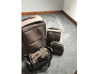 4 piece Tripp suitcase. Vanity case, large and small case and hold-all