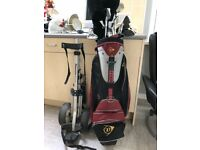 Dunlop golf clubs , caddy glove and shoes