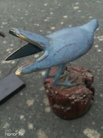 Cast metal birds on perch
