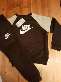 Age 11 to 12 black and grey Nike tracksuit