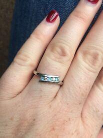 9 carat white gold blue topaz zirconia eternity ring