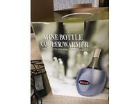 Wine bottle cooler/warmer
