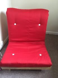 Single red futon