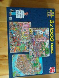 3 x Jan Van Haasteren 1000 Piece Jigsaw puzzles plus posters.