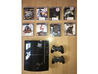 PlayStation 3 60GB with 2 controllers & 8 games (including GTA5, Battlefield4, COD)