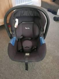 black silver cross car seat