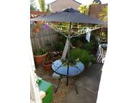 Homebase Garden Andorra Table and umbrella set.
