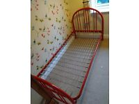 Red, tubular steel bed frame. Single size (3ft). Good condition. No mattress included