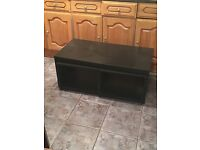 Black coffee table with two tables that pull out inside