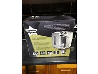 Tommee tippee perfect machine with steriliser and bottle stand.