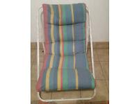 Stripey multi-coloured deck chair