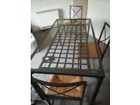 glass top dinner table+4 chairs, 150cmx78cm; good conditions; £50 negotiable