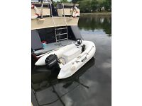 Rigid hull rib with 9.9hp Mercury outboard