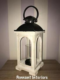 Antique white lantern with chrome top and candle glass holder