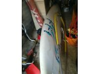 windsurfing board all complete with sail and comes with instructions book vgc