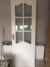 Glass fronted double doors